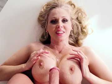 Julia Ann spreads her MILF shaved cunt on the kitchen table for a stepson
